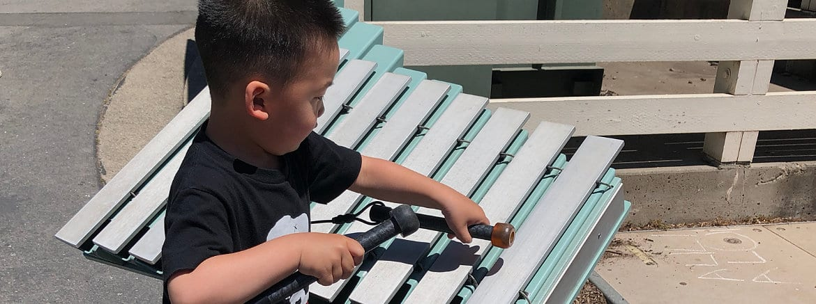 Little Boy Playing with Xylophone