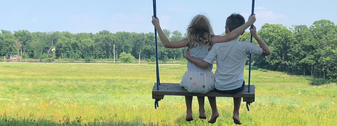Kids Outside on a Swing